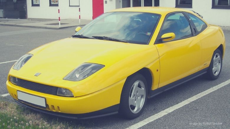 A yellow Fiat Coupe