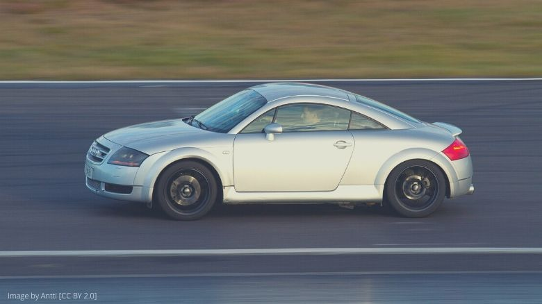 A silver Audi TT driving on a track