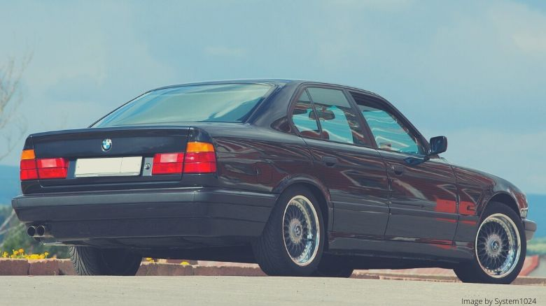A black BMW E34 5-Series