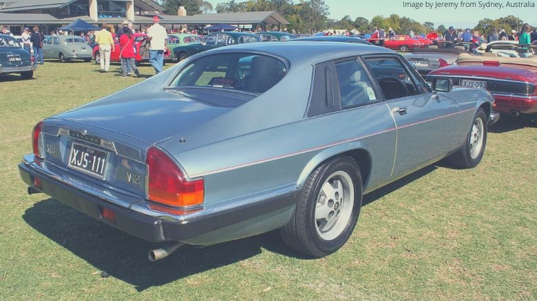 A blue Jaguar XJS at a car show