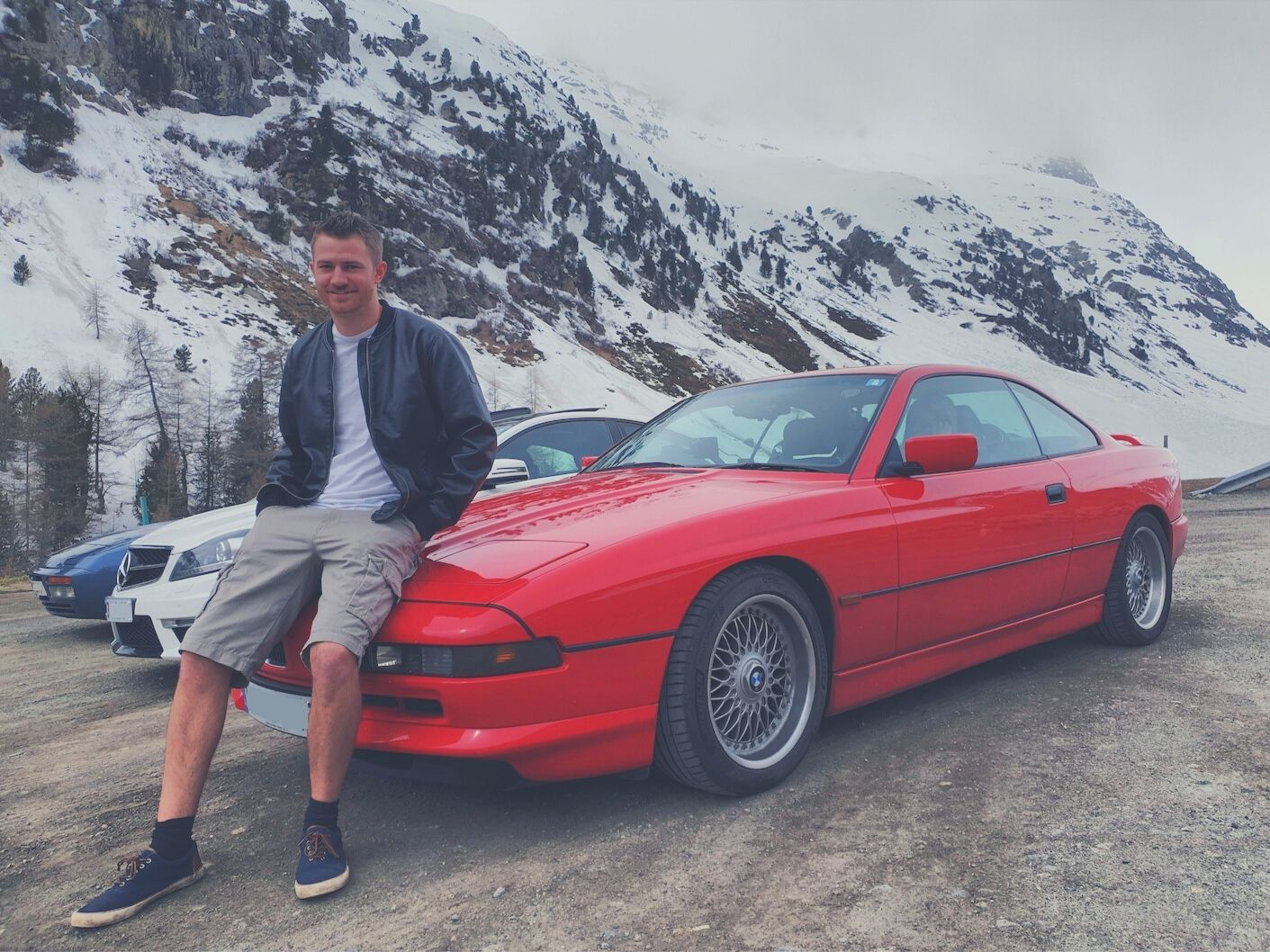 Adam sitting on his BMW 840