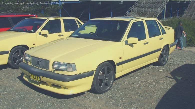 A yellow Volvo 850 R