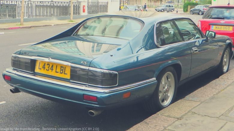 The rear of a green Jaguar XJS