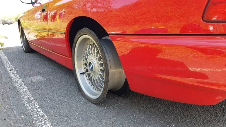 BMW 840 with a blown tire