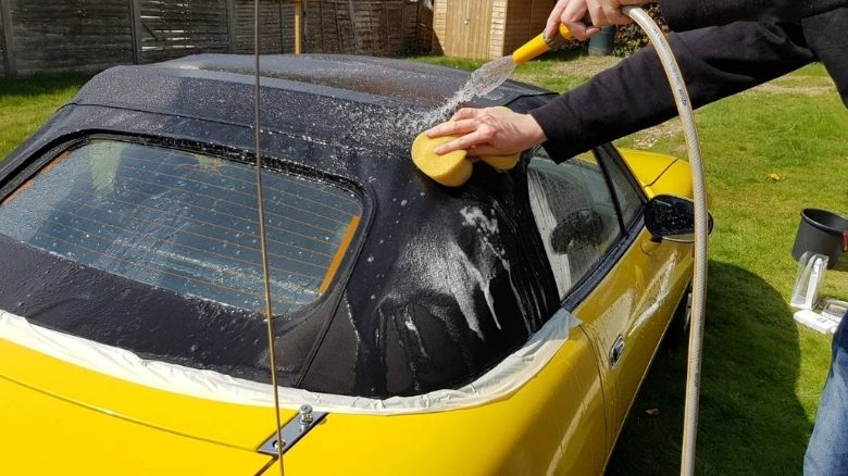 Rinsing down convertible top with sponge