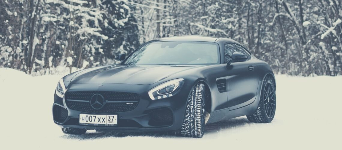 A black Mercedes in snowy conditions