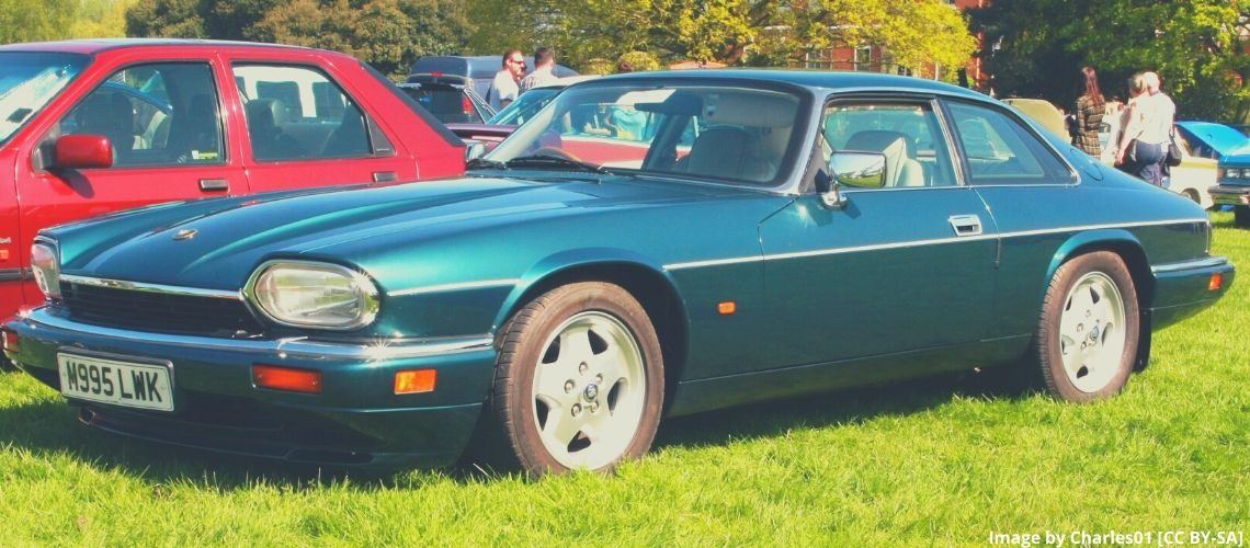 A green Jaguar XJS